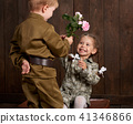 children as soldier in retro military uniform 41346866
