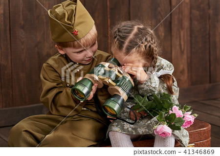 children as soldier in retro military uniform 41346869
