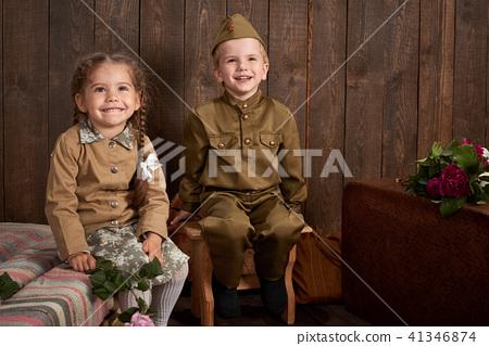 children as soldier in retro military uniform 41346874