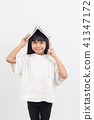 asian little girl put the book on the head 41347172