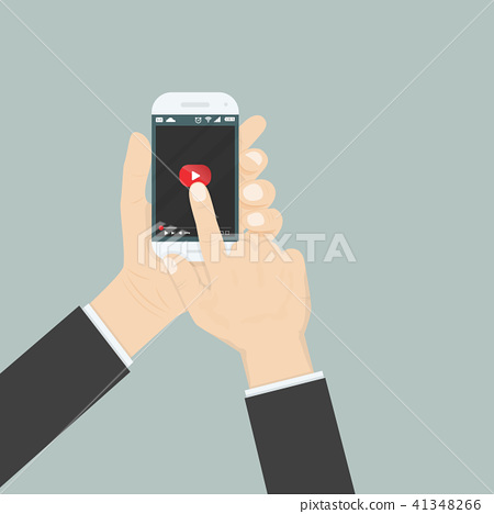 Hand holding smartphone with video player  41348266
