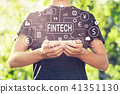 Fintech theme with young man holding his smartphone 41351130