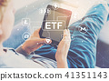 Cryptocurrency ETF theme with man using a tablet  41351143