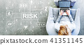 Cryptocurrency Risk Theme with man using a laptop 41351145