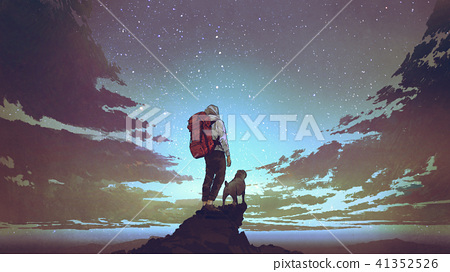 young hiker and dog looking at the sky 41352526
