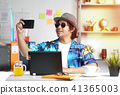 Stylish Young Man Taking Picture While Working 41365003