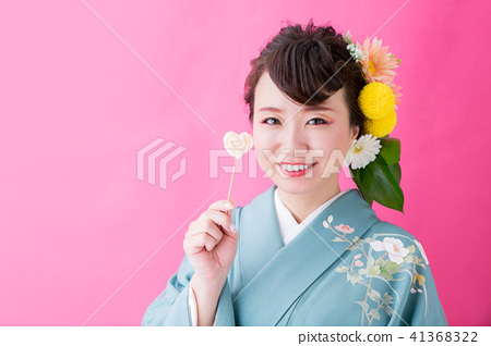 A woman in a kimono with a strange hair makeup 41368322
