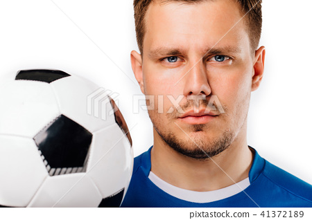 Close-up portrait of young handsome football player soccer posing on white isolated. 41372189