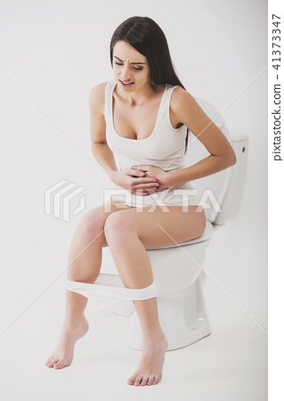 Woman on toilet isolated on white with panties 41373347