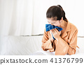 Asian woman sneezing in handkerchief 41376799