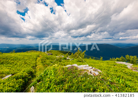 path along the grassy slope on top of a mountain 41382185