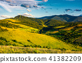 grassy hillsides in high mountains in afternoon 41382209