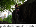 Asian Woman Bouldering in Central Park, New York 41387663