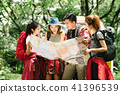 Friends checking direction in map during hike trip 41396539