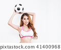 Young sexy woman with soccer ball 41400968