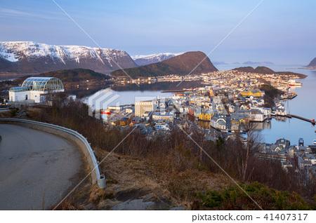 Coastline of Alesund with snowy mountains, Norway 41407317