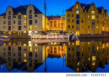 Architecture of Alesund town at night in Norway 41407421