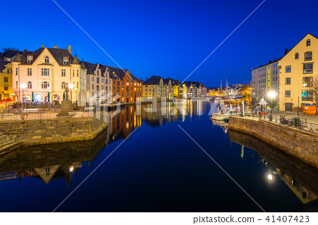 Architecture of Alesund town at night in Norway 41407423