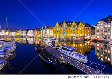 Architecture of Alesund town at night in Norway 41407425