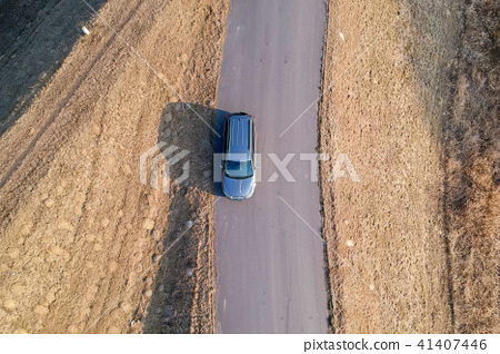 Aerial view of car driving on the road 41407446