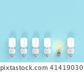 Light bulb among bulb on blue pastel color 41419030