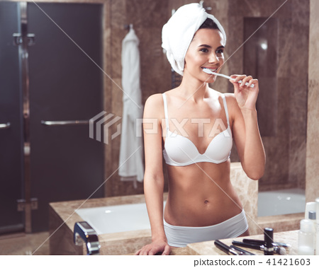 Relaxed girl having morning toilet in bathroom 41421603