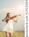 Beautiful women enjoy playing violin 41422009