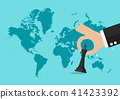 Hand holding chess figure with world map 41423392