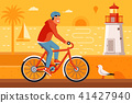 Man Riding Bicycle on Summer Beach 41427940