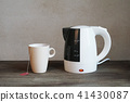 electric water kettle and tea cup 41430087