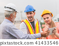 Engineer Teamwork consult together looking 41433546