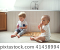 Two toddler children brushing teeth in the bathroom at home. 41438994