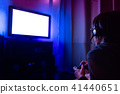 Young male gamer playing video game at home 41440651
