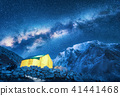 Milky Way, yellow glowing tent and mountains.Space 41441468