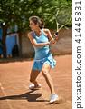 Sportive girl plays tennis 41445831
