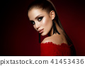 Fashion photo of young magnificent woman in luxury dress. 41453436