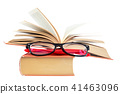 Open book and glasses on a stack of books 41463096