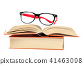 Open book and glasses on a stack of books 41463098