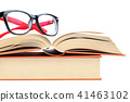 Open book and glasses on a stack of books 41463102