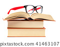 Open book and glasses on a stack of books 41463107