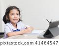 Asian little girl in student uniform doing homewor 41464547