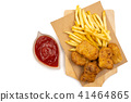 French fries with nuggets and ketchup 41464865