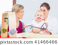 Cute and healthy baby girl playing with the stethoscope during examination 41466466