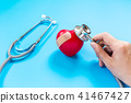 red rubber heart and stethoscope 41467427