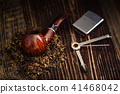 smoking pipe with tobacco leaves 41468042