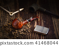 smoking pipe with tobacco leaves 41468044