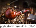 smoking pipe with tobacco leaves 41468045