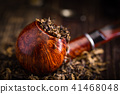 smoking pipe with tobacco leaves 41468048