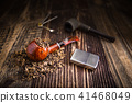 smoking pipe with tobacco leaves 41468049