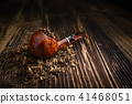 smoking pipe with tobacco leaves 41468051